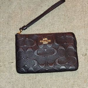 Black leather embossed signature COACH wrislet